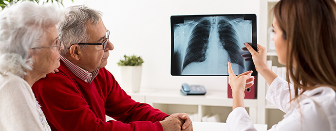 Doctor shows results to patient x-ray of the lungs